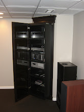 Photo: The entire cabinet slides forward allowing for easy access behind.