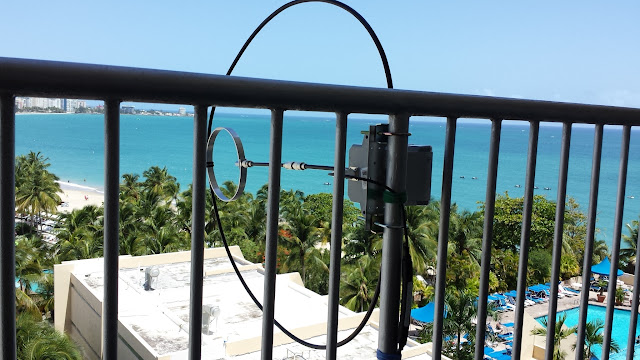 Balcony mounted magnetic loop antenna. Vertical                     orientation. Northwest view towards the Atlantic                     Ocean and North America.
