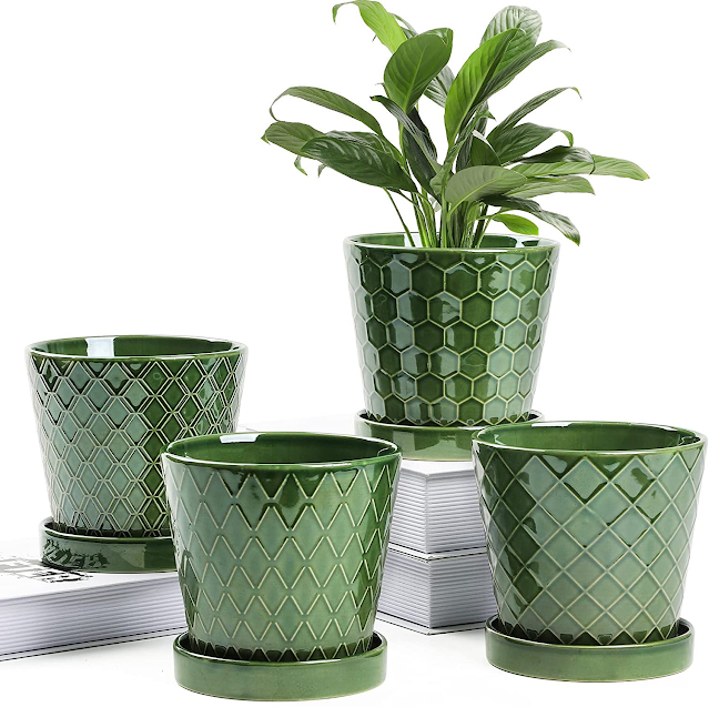 set of four green ceramic houseplant pots.