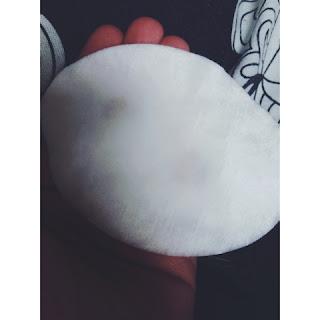 Garnier Micellar Water on a white cotton pad