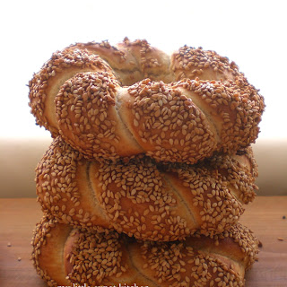 Greek Politiko Simiti / Koulouri (Braided Bread Rings Coated with Grape-Must Syrup and Sesame Seeds).