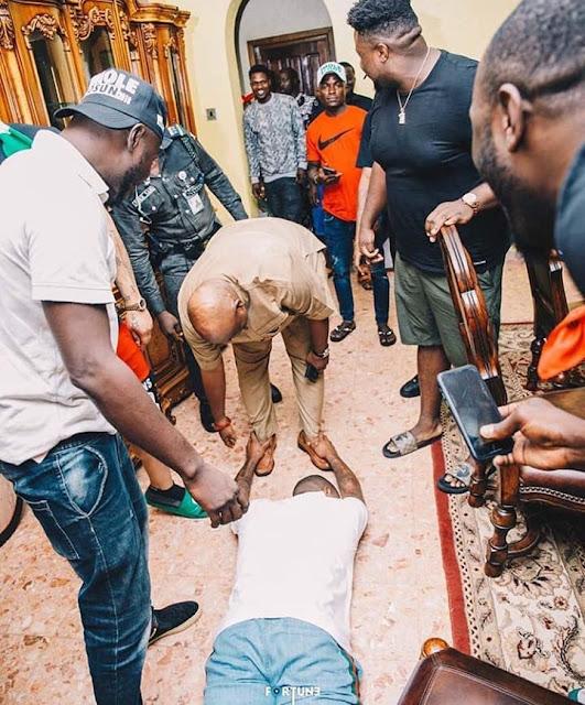 Senator Adeleke at his home town in Osun, Davido was captured as he lie down flat for his uncle Osun state Governorship aspirin Senator Adeleke.