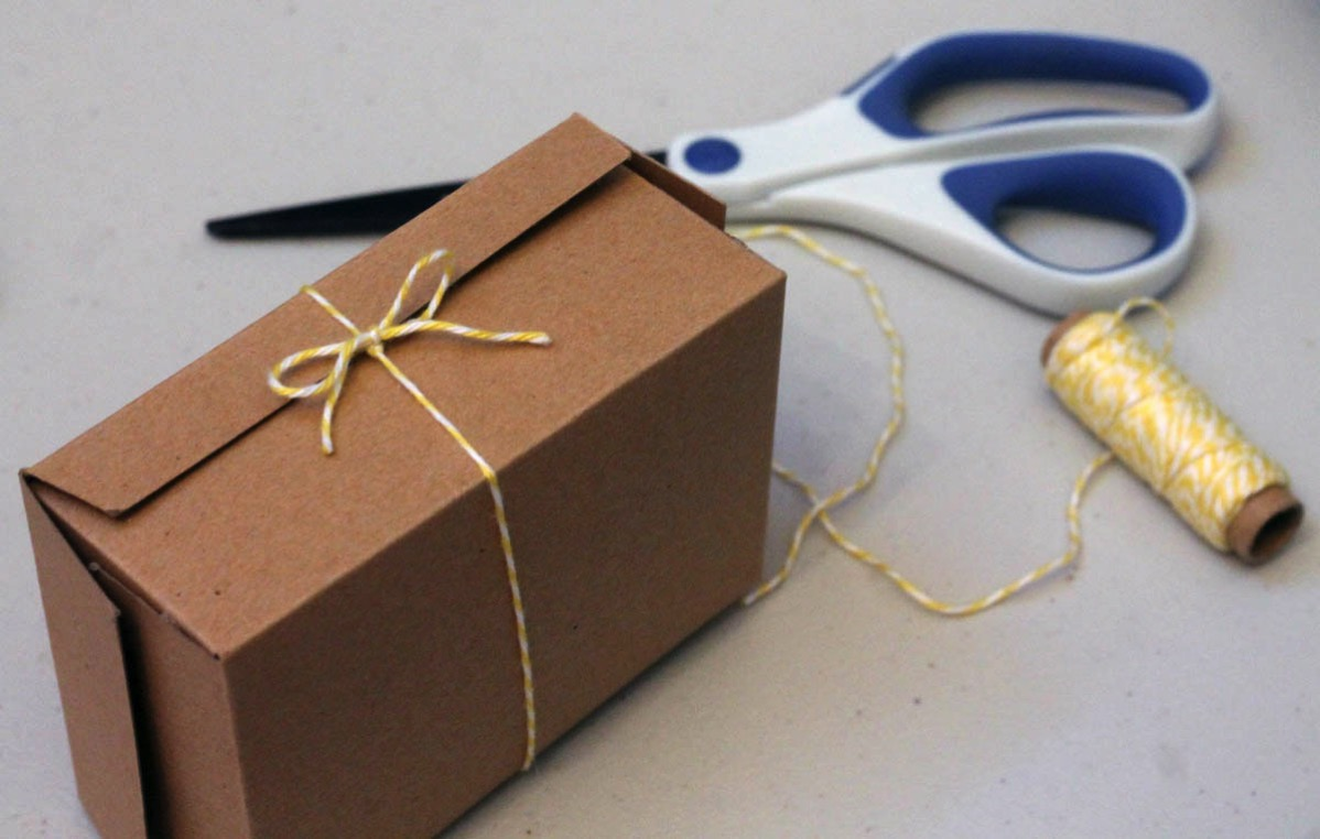 Bakers twine bow on scored chipboard box