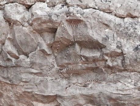 tekstur batu diatas layer teks A.