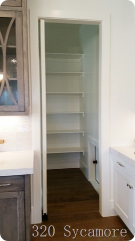 pantry with grocery door