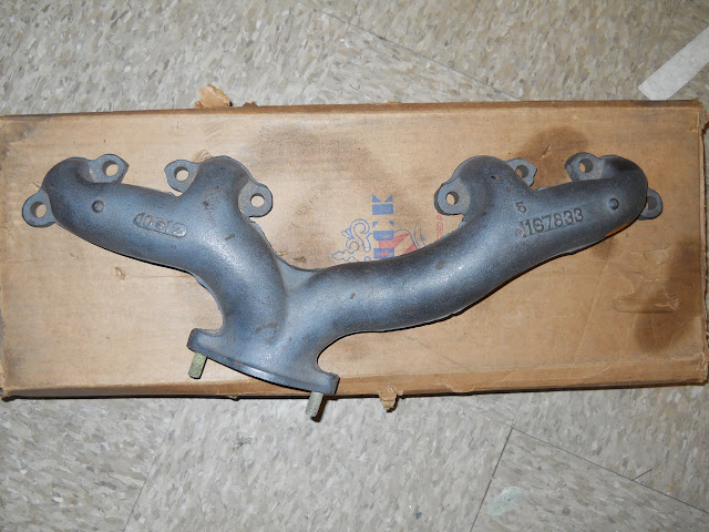 1956 322 left single exhaust manifold, call for price