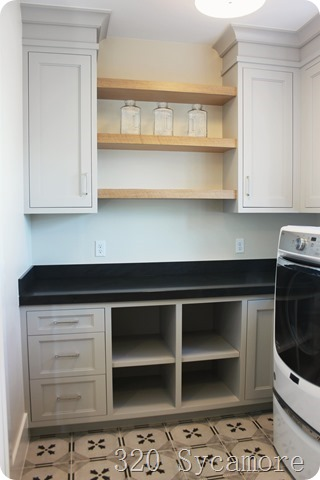 grey laundry room natural wood