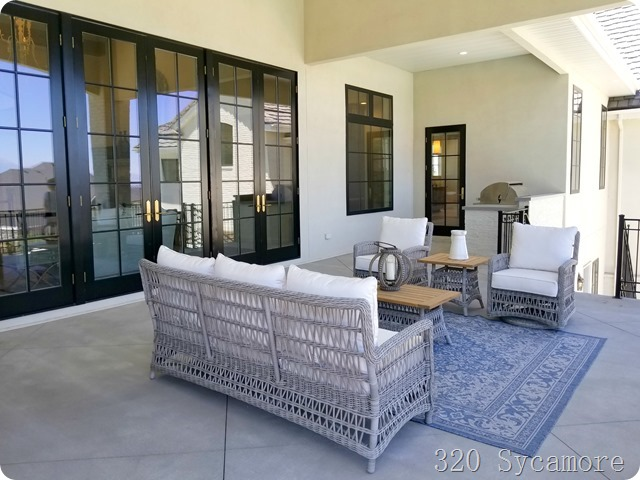 black glass doors patio seating bbq