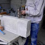 6 - Manual bush hammering of a chiselled door sill