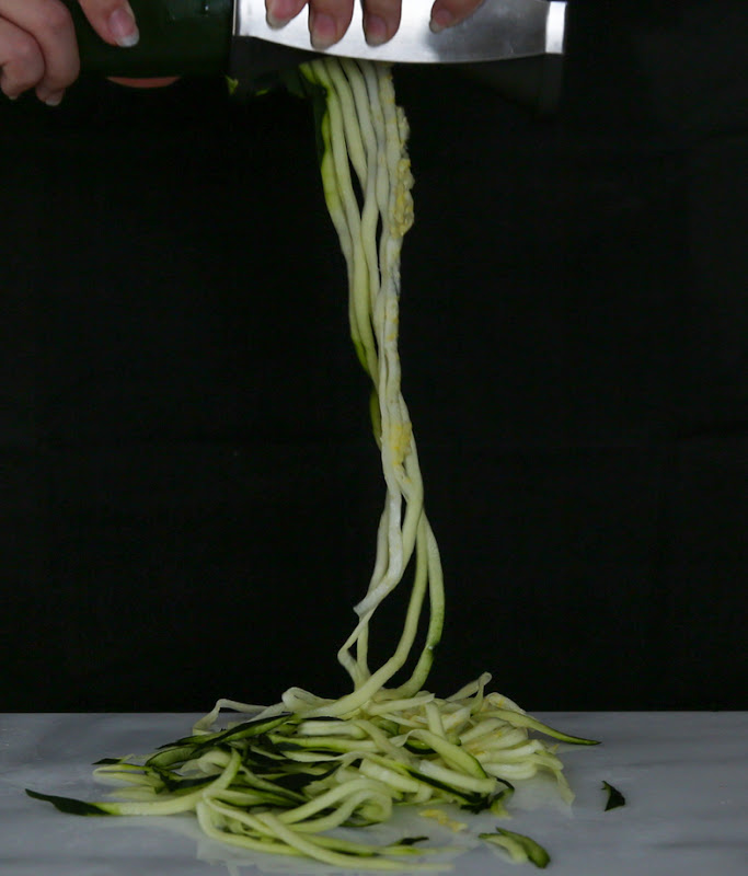 process photo showing zucchini being spiralized
