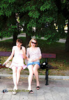Two girls sitting one upshot