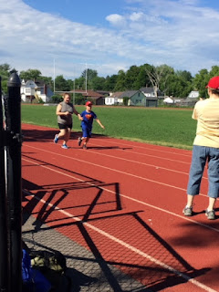 Athlete on the track running with a guide