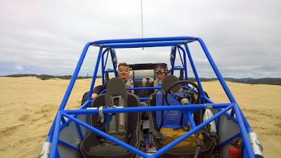 Taking a ride on a Dune Buggy for an Oregon Dunes tour with Sand Dunes Frontier just a little south of Florence, Oregon