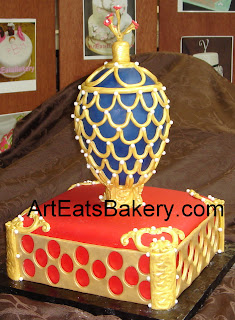Blue and gold Faberge` egg with pearls and flower on red and gold base custom birthday cake