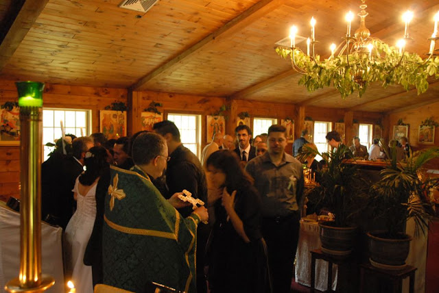 Following the wedding, the guests and parishioners venerate the Cross and greet the newly-wedded Mark and Maria.