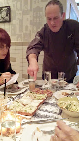 Zakuski, variety of Russian drinking appetizers at DaNet. We were served four types of buterbrodi, here being described by Vitaly Paley as Karen Brooks dutifully takes notes