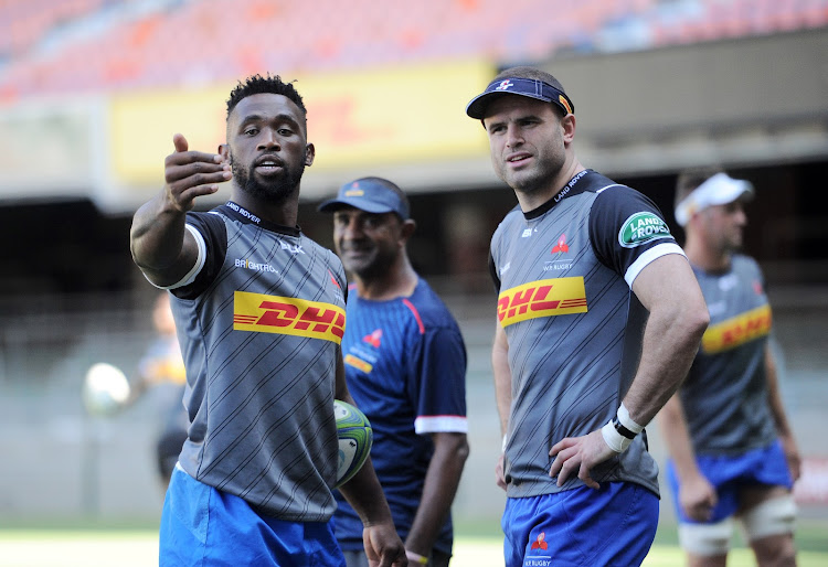 Siya Kolisi and Jamie Roberts in a conversation with Jamie Roberts during training.