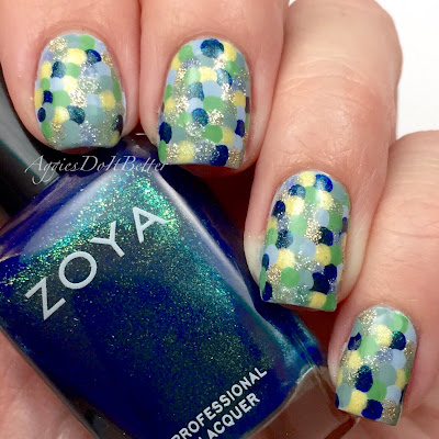 http://www.aggiesdoitbetter.com/2015/02/fish-scale-nails-for-alys-birthday.html