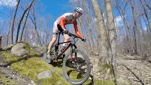 Ben Olson on the mountain bike course Tuesday afternoon, April 11th.