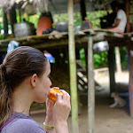 Natalia eating fruit at a local family's house in the rainforest
