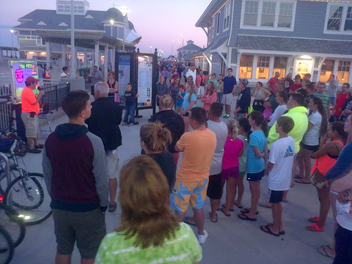 Lots of people stop to listen to the gospel message at the beach!