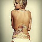 wave sea lower back women - tattoo designs