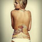 wave sea lower back women - tattoo designs