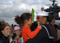 041213-N-2541H-002 Mayport, Fla. (Dec. 13, 2004) - A Sailor reunites with family members after returning home from a successful combat deployment to the Persian Gulf aboard the conventionally powered aircraft carrier USS John F. Kennedy (CV 67). While operating in the 5th Fleet area of responsibility, Kennedy and embarked Carrier Air Wing Seventeen (CVW-17) supported Operations Iraqi Freedom (OIF), Enduring Freedom (OEF) and the Global War on Terrorism. Before leaving the region, Kennedy and CVW-17 provided critical air support for coalition ground troops as part of Al Fajr operations in Fallujah, Iraq. U.S. Navy photo by Photographer's Mate 3rd Class William Heimbuch (RELEASED)