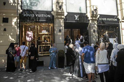 Bargains galore: Tourists, many from Saudi Arabia and Asia, queue outside a Louis Vuitton store in Istanbul on Monday. Picture: REUTERS