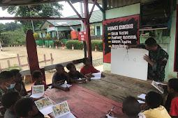 TNI Berikan Bimbingan Belajar Kepada Anak-Anak di Papua.