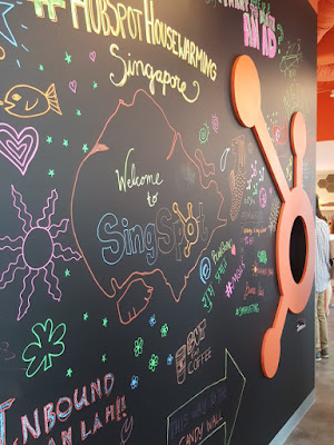 Messages written on a chalkboard wall.