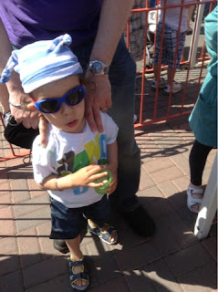 toddler in a pirate hat and sunglasses