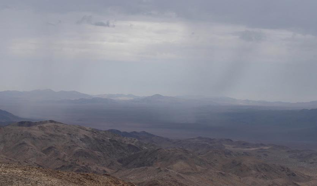 Summer rain showers fall over the desert region about 40 miles northeast of Imperial, California, as seen from Belle Mountain in Joshua Tree National Park, at 12:15 pm PDT 19 July 2017, when the temperature was 100°F (38°C). Photo: National Park Service