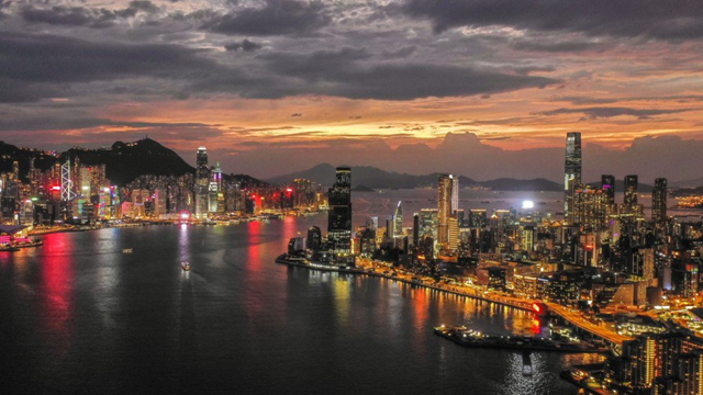 The sun sets behind Hong Kong's skyline as the city braces for Super Typhoon Mangkhut, 15 September 2018. Photo: Roy Issa