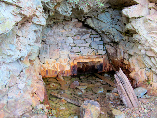 Walled-off mine opening at Animas Forks