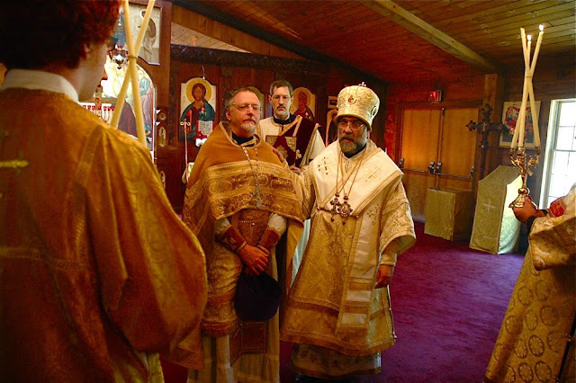 Vladyka presents the newly-elevated Archpriest to his parish, exclaiming Axios!