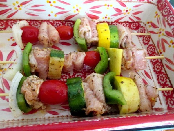 Turn on grill to medium.   Drain marinade from vegetables and chicken and place in...