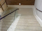 Marble staircase with glass handrail