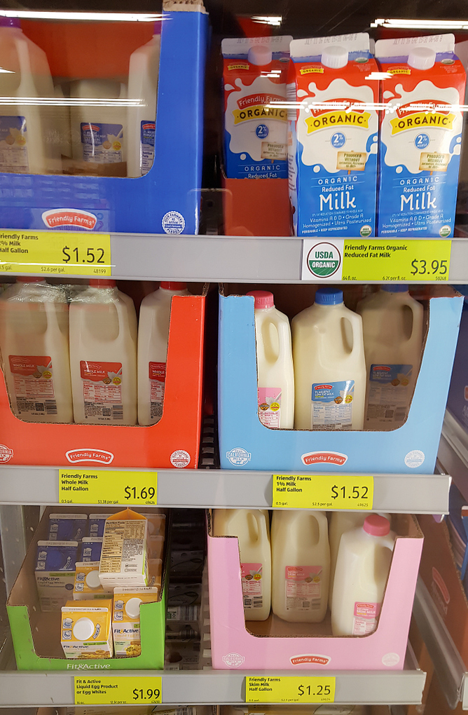 photo of different brands of milk with their prices