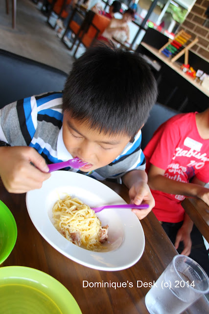 Monkey boy eating their Spaghetti Carbonara