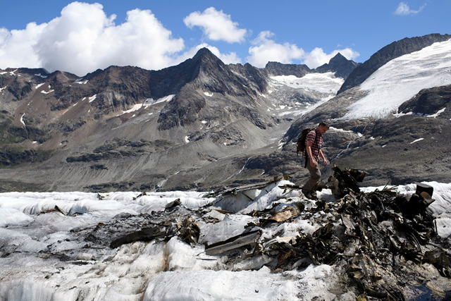 "Some of the debris on Wednesday, 15 August 2018, from a plane crash 70 years ago on the Gauli Glacier in Switzerland. The survival of everyone onboard ""was the most improbable story in the history of international aviation,"" one expert said. The debris was revealed after more than 70 years this month when scorching summer temperatures in Europe caused the glacial ice to recede. Photo: Anthony Anex / EPA / Shutterstock"