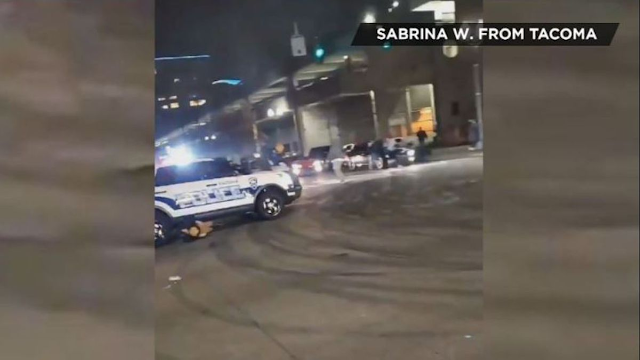 Pedestrian run over by Tacoma police officer surrounded by crowd