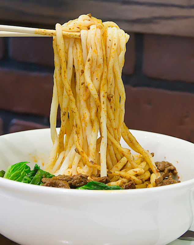 close-up photo of chopsticks holding Special Hot Oil Noodles