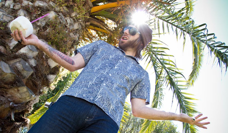 Ben Bawaiian Shirt Drinking Coconut with Straw