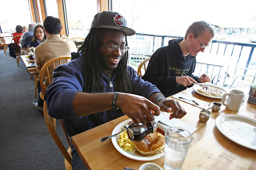 Desmond Murray (cq), left, and co-worker Joel Gifford (cq), dig in during the lunch hour at The Original Pancake House in Kirkland on Friday, April 29, 2011.  [SEATTLE TIMES/JOHN LOK]