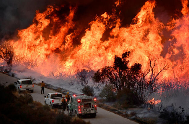 Fire fighters attack the Thomas Fire's north flank with backfires as they continue to fight a massive wildfire north of Los Angeles, near Ojai , California, on 9 December 2017. Fire department spokesman Dave Zaniboni said, 'To see this kind of fire activity in the middle of December, it's just unprecedented.' Photo: Reuters