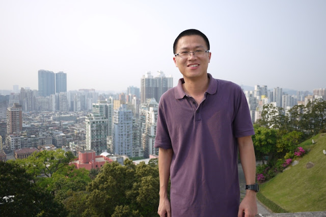 man with Macau scene in background