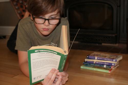 boy reading on the floor