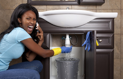 black woman fixing tap