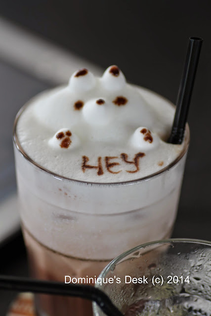 Foam art on a glass of Hot chocolate